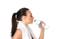A young and fit female is drinking water Stock Image