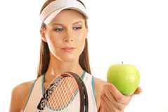 Young and fit female tennis player with an apple Stock Photos