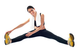 Young fit female trainer doing stretching Stock Photos