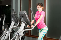 Young fit female training on stepper machine Stock Image