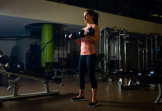 Young and fit female working out in a gym Stock Image