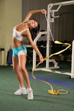 Young fit girl. Healthy young woman with dark hair exercising in the gym. health and wellness, as general fitness and dieting Royalty Free Stock Images