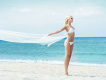 Young and fit girl in bikini on a summer beach Stock Photos