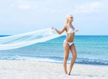 Young and fit girl in bikini on a summer beach Stock Photo