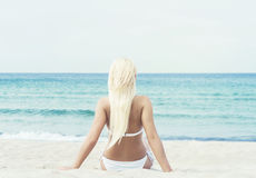Young and fit girl in bikini on a summer beach Stock Image