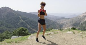 Young fit girl in boxing gloves stock footage