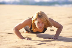 Young fit girl doing push ups Stock Images