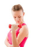 Young fit girl with dumbbells Royalty Free Stock Photography