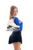 A young and fit girl with winter skates Stock Photo