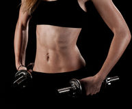 Young fit girl working out with weights Royalty Free Stock Images