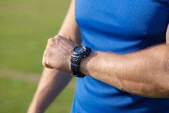 Young fit healthy sportsman is checking time Stock Photography