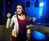 Young fit lady eating light salad Stock Photography