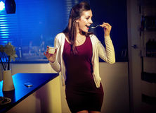 Young fit lady eating yoghurt Royalty Free Stock Image