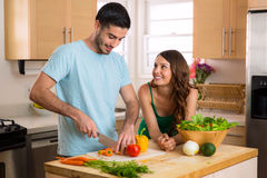 Young fit lovers making health food for lunch and dinner to keep in shape royalty free stock photos