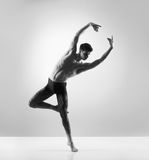 A young and fit male ballet dancer posing in a studio Stock Photo