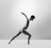 Young and fit male ballet dancer in a studio Royalty Free Stock Photography