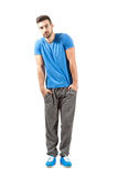 Young fit male in sport outfit with hands in pocket Stock Photos