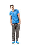 Young fit male in sportswear with hands in pocket Royalty Free Stock Photography