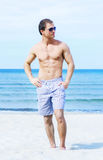 Young and fit man on the beach Stock Photo