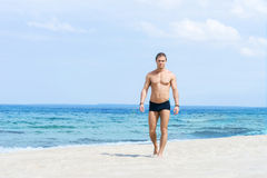 Young and fit man on the beach Stock Image