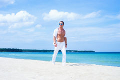 Young and fit man on the beach Royalty Free Stock Photo