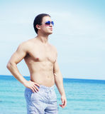 Young and fit man on the beach Royalty Free Stock Photography