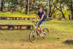 Young fit man during a bike ride on a sunny day stock photography