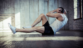 Young fit man exercising in a gym Royalty Free Stock Photography