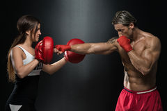 Young Fit Man Fighting A Woman Stock Photography