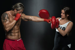Young Fit Man Fighting A Woman Stock Image