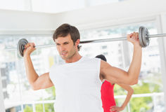 Young fit man lifting the barbell Stock Image