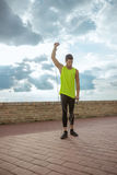 Young fit man resistance band outdoors training arm Royalty Free Stock Images