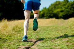 Young fit man running outdoors Royalty Free Stock Image