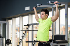 Young fit man wearing sportswear training at the gym Stock Photos