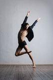 Young and fit modern dancer performing a move Royalty Free Stock Image