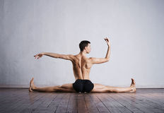 Young and fit modern dancer performing a move Stock Images