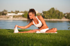 Young and fit. Musclular fit young brunette woman enjoying workout in nature Royalty Free Stock Photo