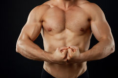 Young fit sportsman is straining his muscles Royalty Free Stock Photo