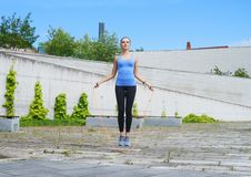 Young, fit and sporty woman. Fitness, sport, urban and healthy lifestyle concept. Stock Photos