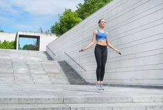 Young, fit and sporty woman. Fitness, sport, urban and healthy lifestyle concept. Stock Images