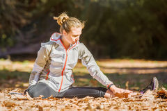 Young fit sporty woman stretching before jogging Royalty Free Stock Photo