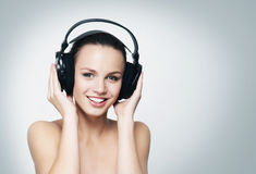 A young and fit teenage girl listening to music in headphones Royalty Free Stock Photos