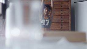 Young fit and tone up woman doing stretching routine in sunny loft. Young fit and tone up african american woman doing stretching routine before or after workout stock video