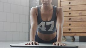 Young fit and tone up woman doing fitness workout with plank elements for strenght abs in sunny loft. Young fit and tone up woman has a rest after fitness Stock Images