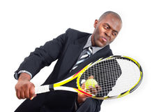 Young fit and vigorous. Business man concept. black african american man well dressed in formal suit and necktie playing tennis. white isolated copyspace Stock Images