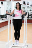 Young fit woman. Exercising in the gym Royalty Free Stock Photography