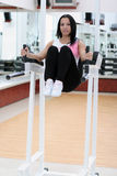 Young fit woman. Exercising in the gym Stock Photography
