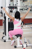 Young fit woman. Exercising in the gym Stock Images
