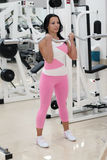 Young fit woman. Exercising in the gym Royalty Free Stock Image