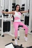 Young fit woman. Exercising in the gym Stock Photo
